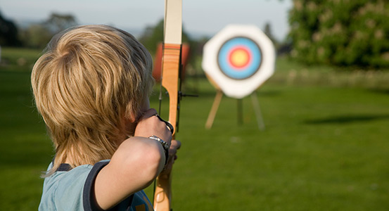 Archery - Boy aims at target